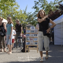 Customers at the Salt Spring Island Saturday Market, Ganges, Salt Spring Island, British Columbia