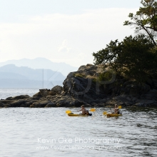 Two boys kayaking, Tent Island, Gulf Islands, British Columbia, Canada