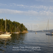 Sailboats in the anchorage with Crofton in the background, Tent Island, Gulf Islands, British Columbia, Canada