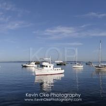 Boats at anchor in calm water at Princess Bay, Portland Island, British Columbia, Canada