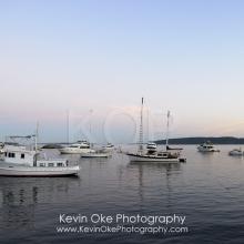 Boats anchored in Princess Bay at sunset, Portland Island, British Columbia, Canada