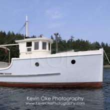 Old wood fishing boat at anchor, Portland Island, British Columbia, Canada