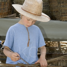 Young boy weaving a basket at the Salt Spring Island Saturday Market located in Ganges, Ganges, Salt Spring Island, British Columbia