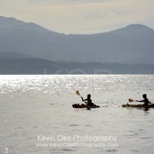 Two kids kayaking in front of Vancouver Island, Tent Island, Gulf Islands, British Columbia, Canada