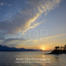 Sunset over Vancouver Island with clouds, Tent Island, Gulf Islands, British Columbia, Canada