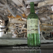Old wine bottle in the boat sign building, Wallace Island, Gulf Islands, British Columbia, Canada