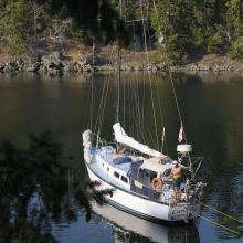Sailboat shore tied in Princess Bay, Wallace Island, Gulf Islands, British Columbia, Canada