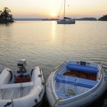 Two dinghy's in the water at sunset, Wallace Island, Gulf Islands, British Columbia, Canada