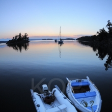 Two dinghy's at sunset, Wallace Island, Gulf Islands, British Columbia, Canada