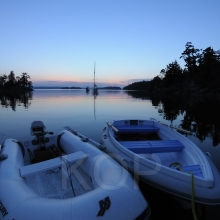 Tenders at dusk with boats in the backgroundWallace Island, Gulf Islands, British Columbia, Canada